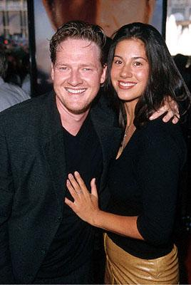 Donal Logue with his arm around a woman at the Loews Century Plaza premiere of Columbia's The Patriot