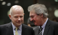 British Foreign Minister William Hague, left, speaks with Luxembourg's Foreign Minister Jean Asselborn during a meeting of EU foreign ministers at the EU Council building in Brussels on Monday, Jan. 23, 2012. EU foreign ministers are expected on Monday to agree to new economic sanctions against Iran over its nuclear program. (AP Photo/Virginia Mayo)