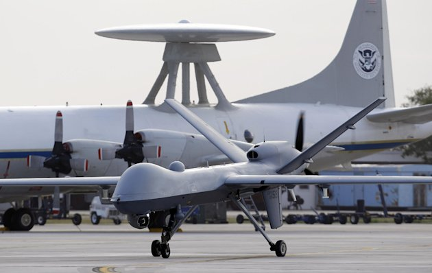 FILE - In this Nov. 8, 2011 file photo, a Predator B unmanned aircraft taxis at the Naval Air Station in Corpus Christi, Texas. The Pentagon for the first time is considering scaling back the massive build-up of drones conducted in the past few years, both to save money and to adapt to new areas of operation, such as Asia, as the Afghanistan war winds down. The downsizing would not affect the current drone campaign against terror suspects in Afghanistan, Pakistan, Yemen and elsewhere. (AP Photo/Eric Gay, File)