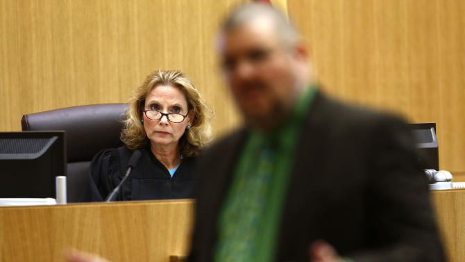 Judge Sherry Stephens listens to defense attorney Kirk Nurmi address the jury on Wednesday, May 15, 2013, during the sentencing phase of the Jodi Arias murder trial at Maricopa County Superior Court in Phoenix. If the jury finds aggravating factors in her crime, Arias could be sentenced to death.   (AP Photo/The Arizona Republic, Rob Schumacher, Pool)