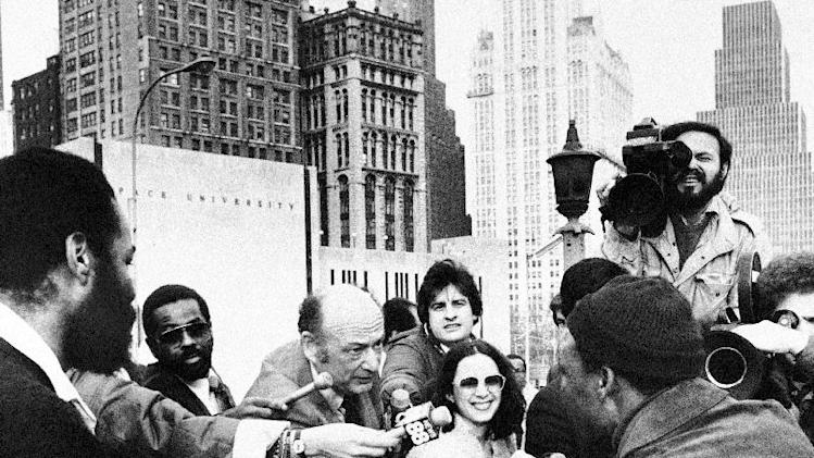 "FILE - In this Monday, April 7, 1980 file photo, New York Mayor Edward Koch greets a commuter who had walked across the Brooklyn Bridge upon his arrival on the Manhattan side, New York. Surrounded by news reporters, Mayor Koch told New Yorkers crossing the Brooklyn Bridge that they were on a ""bridge over troubled waters"" but that the city would survive the transit strike. Koch, the combative politician who rescued the city from near-financial ruin during three City Hall terms, has died at age 88. Spokesman George Arzt says Koch died Friday morning Feb. 1, 2013 of congestive heart failure. (AP Photo/Carlos Rene Perez)"