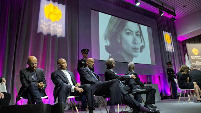 A photo of beloved literary figure Joan Didion, is projected on a screen as she's honored during the 8th Annual California Hall of Fame on Wednesday, Oct. 1, 2014 in Sacramento, Calif. (AP Photo/The Sacramento Bee, Hector Amezcua, POOL)
