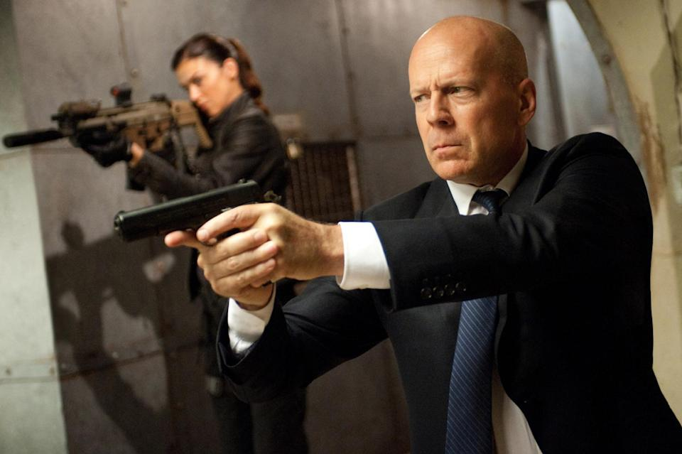"This film image released by Paramount Pictures shows Adrianne Palicki, left, and Bruce Willis in a scene from ""G.I. Joe: Retaliation."" (AP Photo/Paramount Pictures, Jaimie Trueblood)"