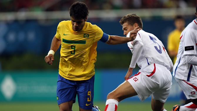 Brazil's Henrique Nascentes, left, fights for the ball with Costa Rica's Gualberto Montenegro during a men's soccer match at the Pan American Games in Guadalajara, Mexico, Sunday, Oct. 23, 2011. (AP Photo/Juan Karita)