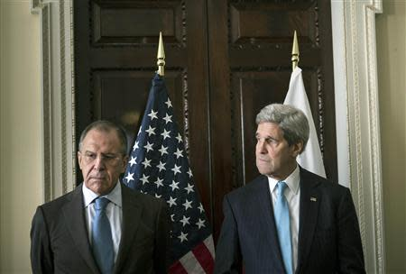U.S. Secretary of State John Kerry and Russia's Foreign Minister Sergei Lavrov stand together before their meeting at the home of the U.S. ambassador in London