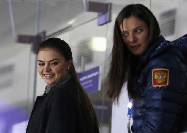 Olympic champion gymnast-turned parliamentarian Kabayeva and double Olympic pole vault champion Isinbayeva look on as Russia defeats Slovakia in a shootout during their men's preliminary round ice