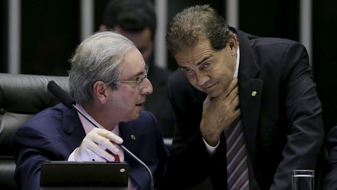 President of the Chamber of Deputies deputy Cunha talks with deputy Pereira during a session of the chamber in Brasilia