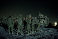 Infantry men from the 1st platoon, Delta coy. attend a briefing prior to embarking on a night patrol from Lindsey foward operating base in Kandahar province, Afghanistan