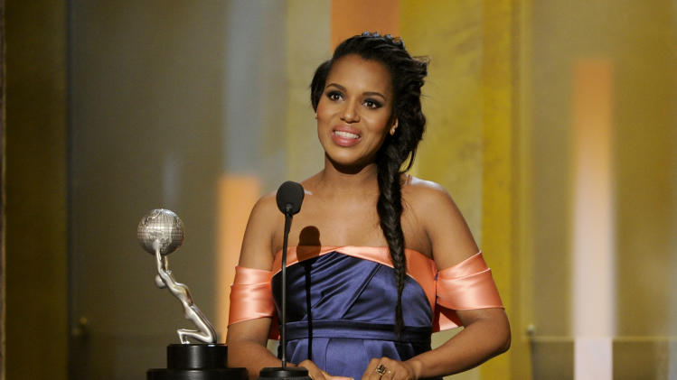 "Kerry Washington accepts the award for outstanding actress in a drama series for ""Scandal"" at the 45th NAACP Image Awards at the Pasadena Civic Auditorium on Saturday, Feb. 22, 2014, in Pasadena, Calif. (Photo by Chris Pizzello/Invision/AP)"