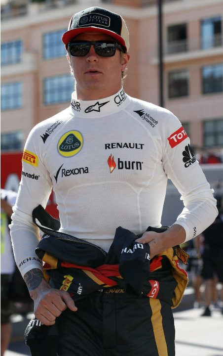 Lotus Renault Formula One driver Raikkonen of Finland arrives before the first practice session of the Monaco F1 Grand Prix