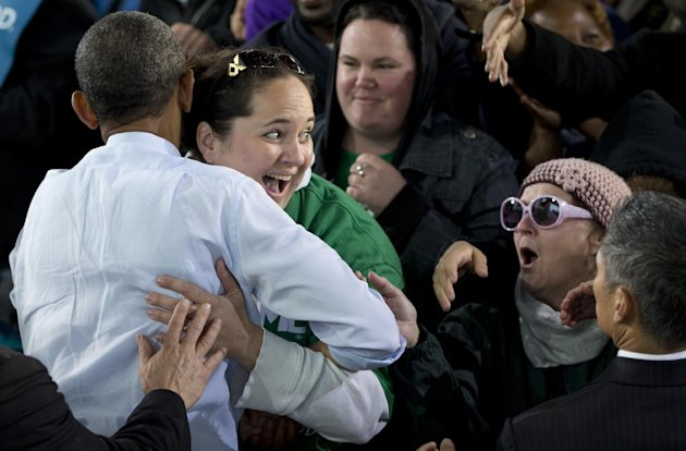 President Barack Obama is hugged by a woman as he greets people at a campaign event at the Summerfest Grounds at Henry Maier Festival Park, Saturday, Sept. 22, 2012, in Milwaukee. (AP Photo/Carolyn Ka