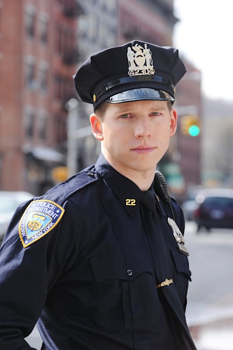 "Stark Sands stars as Officer Kenny McLaren in ""NYC 22."""