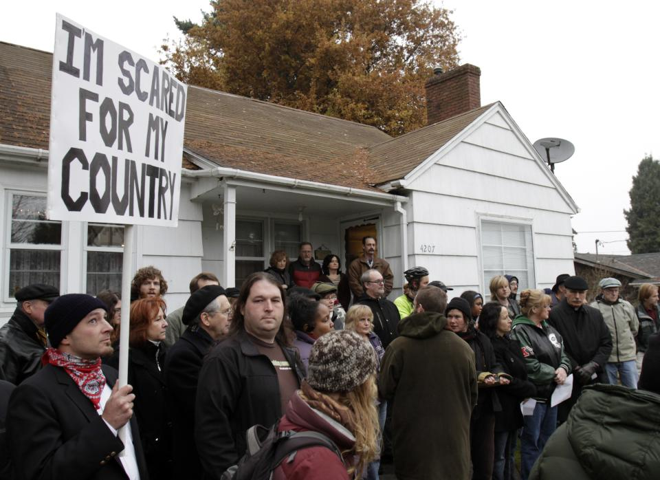 "Homeowners and demonstrators gather in front of a home where the owner has been given an eviction notice in Portland, Ore., Tuesday, Dec. 6, 2011.  Following tactics by Occupy Wall Street demonstrators in Seattle, Portland and Oakland, protesters across the country are staging ""Occupy Homes"" actions nationally to try to stop foreclosures. (AP Photo/Don Ryan)"