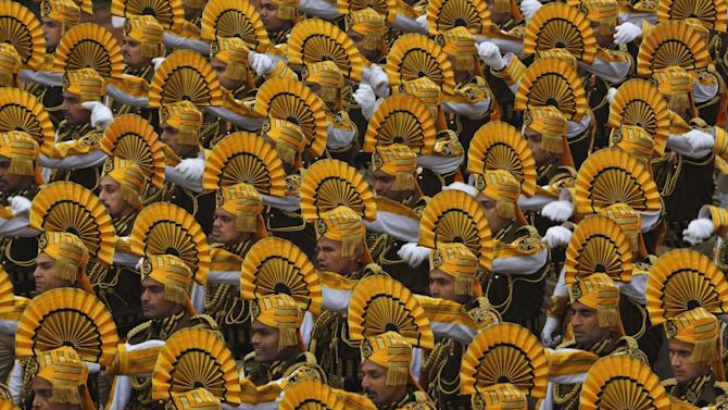 Indian paramilitary soldiers march during the Republic Day parade in New Delhi, India, Monday, Jan. 26, 2015. Republic Day marks the anniversary of India's democratic constitution taking force in 1950. Beyond the show of military power, the parade includes ornate floats highlighting India's cultural diversity. (AP Photo /Manish Swarup)