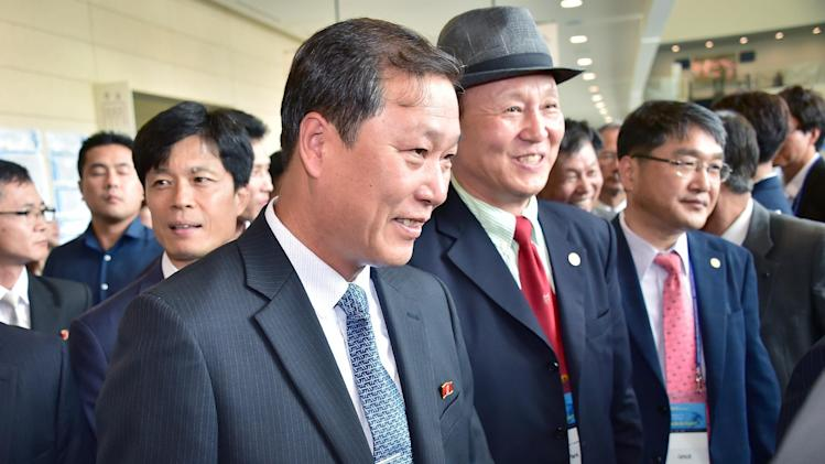 Yang Song-Ho (C), the dean of the Korean University of Physical Education in Pyongyang, arrives to attend an international conference on sport's role in improving relations among Asians, in Incheon, on August 20, 2014