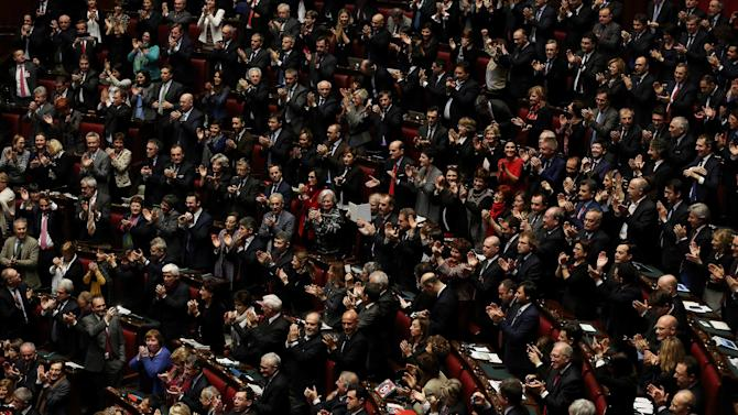 PD (Democratic Party) members celebrate after the election of the Italy's new President Sergio Mattarella in the lower house of parliament in Rome