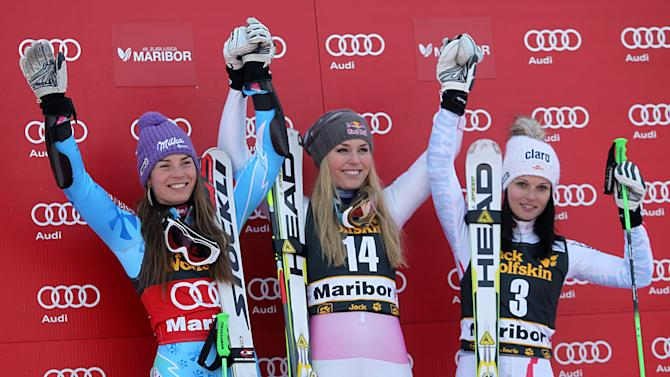 From left, Slovenia Tina Maze, second placed, Lindsey Vonn, the winner, of the United States, and third placed Austria's Anna Fenninger celebrate on podium after winning an alpine ski, women's World Cup giant slalom, in Maribor, Slovenia, Saturday, Jan. 26, 2013. (AP Photo/PierMarco Tacca)