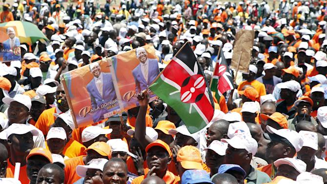 Supporters of Kenyan Prime Minister and Presidential candidate, Raila Odinga, gather at Nyayo National Stadium in Nairobi, Kenya, Saturday, March 2, 2013, for the final day of the campaign for the upcoming election.  Kenya's top two presidential candidates are holding their final rally before the country votes on Monday March 4.(AP Photo/Sayyid Azim)