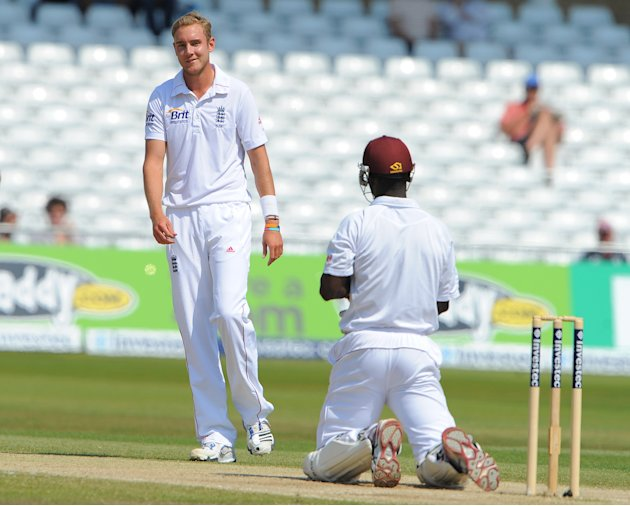England's Stuart Broad (L) reacts toward