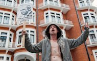<p>A supporter of Julian Assange demonstrates outside the Ecuadoran embassy in London on August 17. Russia on Friday warned Britain against violating fundamental diplomatic principles after London suggested it could arrest WikiLeaks founder Julian Assange inside Ecuador's embassy.</p>