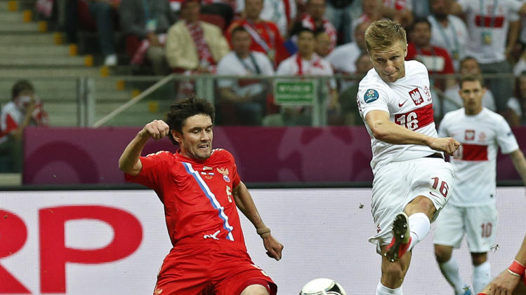 Poland's Jakub Blaszczykowski scores by Russia's Yuri Zhirkov during the Euro 2012 soccer championship Group A match between Poland and Russia in Warsaw, Poland, Tuesday, June 12, 2012. (AP Photo/Matt Dunham)