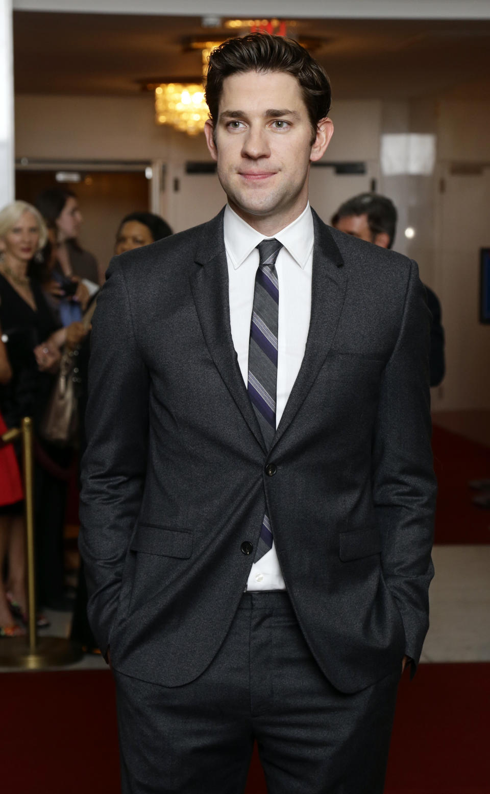 Actor John Krasinski poses for photographers on the red carpet before entertainer Ellen DeGeneres receives the 15th annual Mark Twain Prize for American Humor at the Kennedy Center, Monday, Oct. 22, 2012, in Washington. (AP Photo/Alex Brandon)
