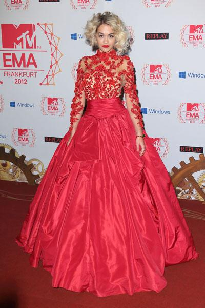 Rita Ora: Somewhere out there, Scarlett O'Hara is missing some curtains. Singer Rita Ora makes sure all eyes are on her in a voluminous fire red lace gown. The detailed lace bits against the sheer fabric is pretty but that skirt needs to be taken down a few layers. (Photo by Mike Marsland/WireImage)