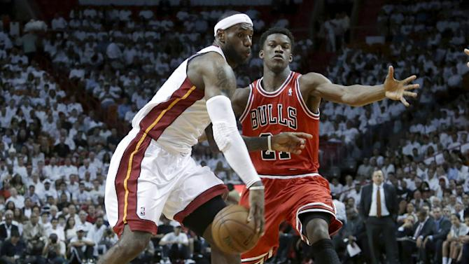 Miami Heat forward LeBron James, left, passes around Chicago Bulls forward Jimmy Butler during the first half of Game 1 of the NBA basketball playoff series in the Eastern Conference semifinals, Monday, May 6, 2013 in Miami. (AP Photo/Lynne Sladky)