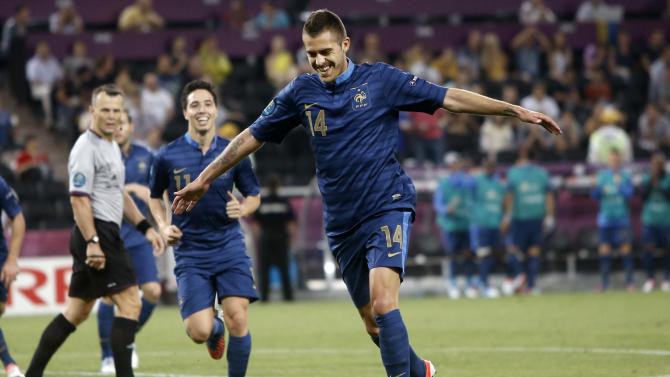 France's Jeremy Menez, right,  celebrates after scoring a goal during the Euro 2012 soccer championship Group D match between Ukraine and France in Donetsk, Ukraine, Friday, June 15, 2012. (AP Photo/Laurent Cipriani)