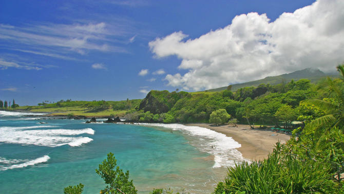"""FILE - This undated file photo provided by Ron Dahlquist for the Maui Visitors Bureau shows Hamoa Beach in Maui, Hawaii. Hamoa Beach is fourth on the 2013 list of Top 10 Beaches produced annually by coastal expert Stephen P. Leatherman, also known as """"Dr. Beach,"""" director of Florida International University's Laboratory for Coastal Research.   (AP Photo/MVB, Ron Dahlquist)   MANDATORY CREDIT: MVB/RON DAHLQUIST."""