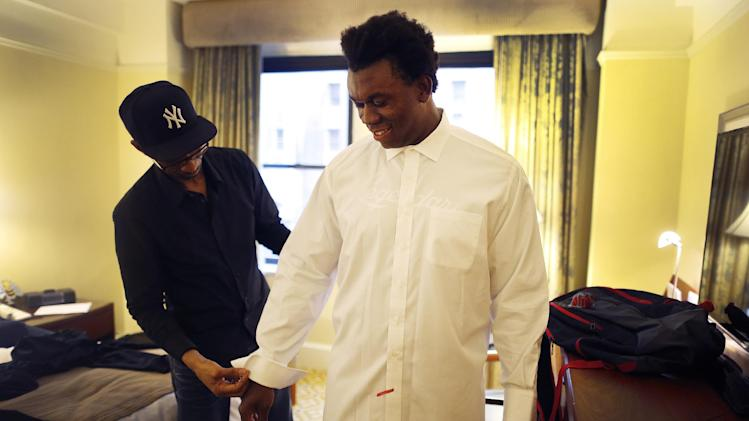 IMAGE DISTRIBUTED FOR NIKE - Ziggy Ansah, defensive end from Brigham Young University, has his suit tailored the day before the 2013 NFL Draft, Wednesday, April 24, 2013, in New York City, New York. (John Minchillo/AP Images for NIKE)