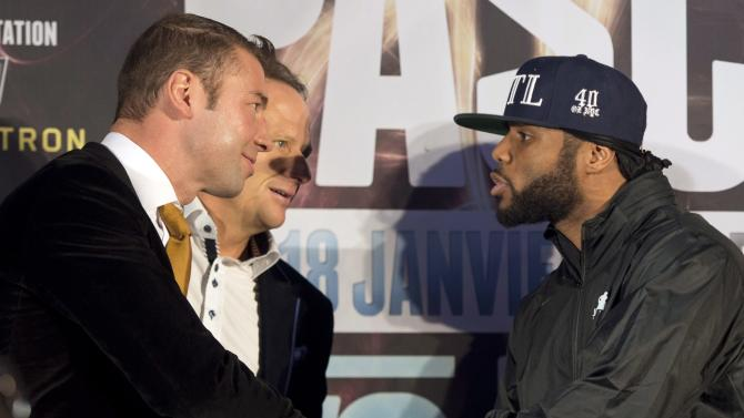 Lucian Bute, left, and Jean Pascal, shake hands after a news conference, Wednesday, Jan. 15, 2014 in Montreal. The two Canadian boxers will meet in a WBC Diamond light heavyweight title fight Saturday, Jan. 18, 2014 in Montreal