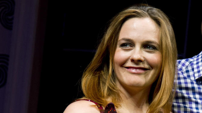 "Alicia Silverstone appears at the curtain call for the opening night performance of the Broadway play ""The Performers"" on Wednesday, Nov. 14, 2012 in New York. (Photo by Charles Sykes/Invision/AP)"