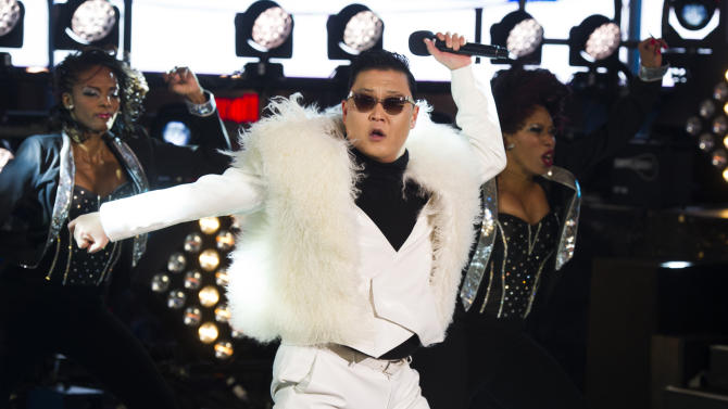 Psy performs in Times Square during New Year's Eve celebrations on Monday, Dec. 31, 2012 in New York. (Photo by Charles Sykes/Invision/AP)