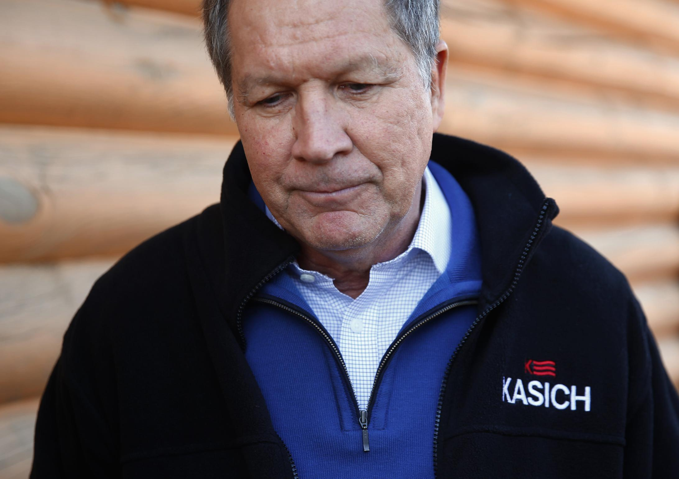 The Latest: Group backing Bush hits Kasich over defense