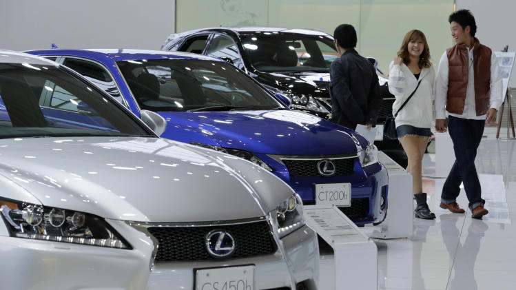 Toyota quarterly profit triples, raises forecast