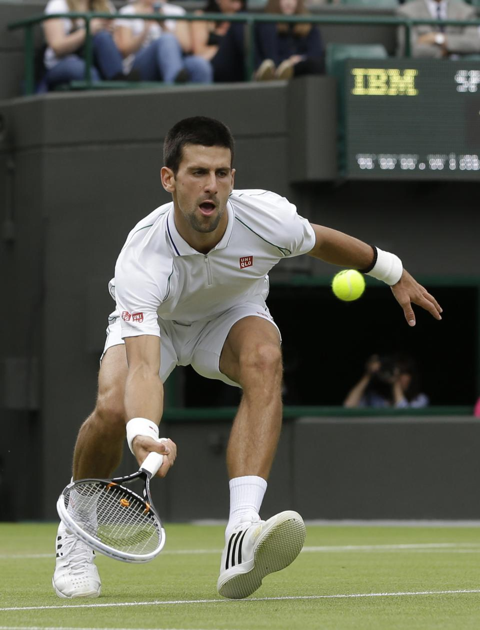 Novak Djokovic of Serbia plays a return to Florian Mayer of Germany during a quarterfinals match at the All England Lawn Tennis Championships at Wimbledon, England, Wednesday, July 4, 2012. (AP Photo/Kirsty Wigglesworth)