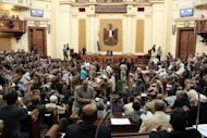 First session of the Egyptian parliament in Cairo. Egypt's Supreme Constitutional Court froze on Tuesday a decree presidential decree reinstating the Islamist-led parliament, hours after the lower house convened in defiance of the judiciary and military