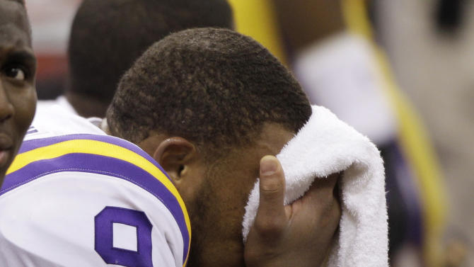 LSU's Jordan Jefferson wipes his face on the bench during the second half of the BCS National Championship college football game against Alabama Monday, Jan. 9, 2012, in New Orleans. (AP Photo/David J. Phillip)