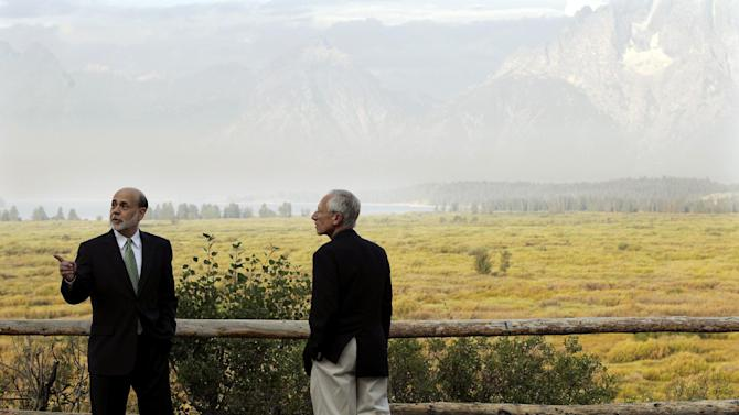 FILE - In this Friday, Aug. 31, 2012, file photo, Federal Reserve Chairman Ben Bernanke, left, and Stanley Fischer, right, Governor of the Bank of Israel, talk together outside the Jackson Hole Economic Symposium, at Grand Teton National Park near Jackson Hole, Wyo. Despite the absence of the Federal Reserve chairman the 2013, Annual economic conference in Jackson Hole has once again proved a destination of choice for central bankers. (AP Photo/Ted S. Warren, File)