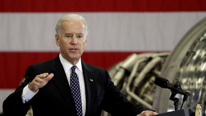 Vice President Joe Biden talks to workers of a Rochester company that has partnered with a local college, Thursday, Jan. 26, 2012 in Rochester, N.H. (AP Photo/Jim Cole)