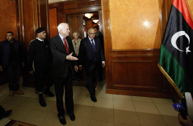 Libyan PM Zeidan and U.S. Senator McCain leave a meeting at the headquarters of the Prime Minister's Office in Tripoli