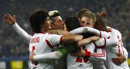 FC Salzburg's Jonatan Soriano (3rd L) celebrates with team mates their team's goal against Ajax Amsterdam during their Europa League soccer match in Salzburg February 27, 2014. REUTERS/Michael