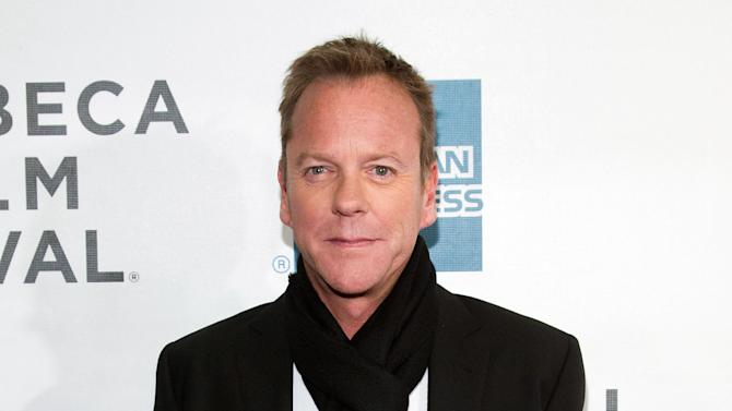 """FILE - This April 21, 2013 photo shows actor Kiefer Sutherland at the premiere of """"The Reluctant Fundamentalist"""" during the 2013 Tribeca Film Festival in New York. """"Metal Gear Solid"""" creator Hideo Kojima says Sutherland will play protagonist Snake in the next installment of the stealth video game series. The character has been portrayed by voice actor David Hayte since the first """"Metal Gear Solid"""" game in 1998. (Photo by Dario Cantatore/Invision/AP, file )"""
