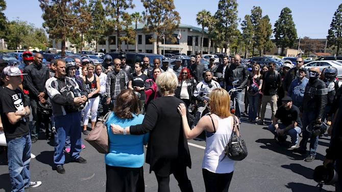 Bikers, military personnel and friends of U.S. Navy Chief Petty Officer Buob gather around Boub's aunt Maryanne and family friend Kathy outside court following the arraignment of Darla Renee Jackson in Chula Vista