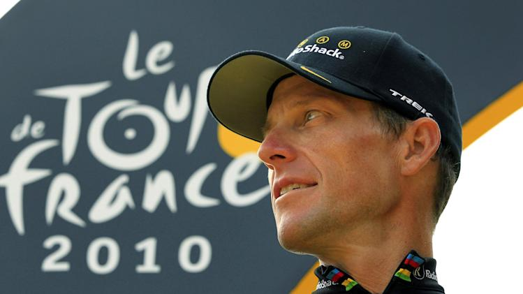 FILE - In this July 25, 2010, file photo,  Lance Armstrong looks back on the podium after the 20th and last stage of the Tour de France cycling race in Paris, France. The U.S. Anti-Doping Agency says its review board has made a unanimous recommendation to file formal doping charges against Armstrong. That will move the case to an arbitration hearing if Armstrong chooses to challenge, as he has indicated he would. (AP Photo/Bas Czerwinski, File)