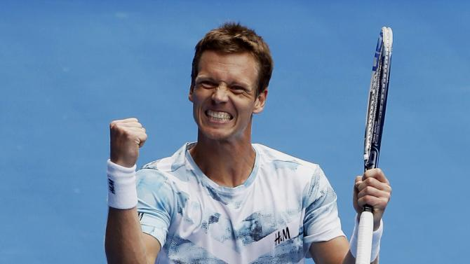 Berdych of the Czech Republic celebrates after defeating Nadal of Spain in their men's singles quarter-final match at the Australian Open 2015 tennis tournament in Melbourne