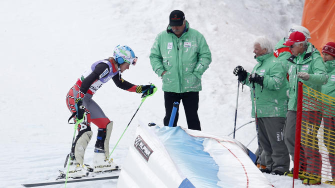 United States' Ted Ligety leaves the slope after missing a gate during the first run of the men's slalom at the Alpine skiing world championships in Schladming, Austria, Sunday, Feb.17,2013. (AP Photo/Matthias Schrader)