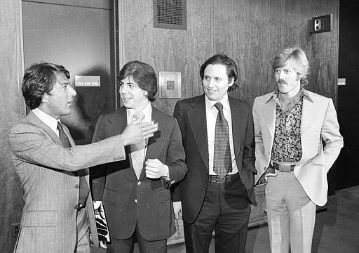 "Washington Post reporters Carl Bernstein, second from left, and Bob Woodward, third from left, are flanked by actors Dustin Hoffman and Robert Redford as they attend the premiere of the motion picture ""All the President's Men,"" in Washington, D.C., on April 5, 1976. The film is based on the two reporters' book documenting their investigation of the Watergate Scandal. (AP Photo)"