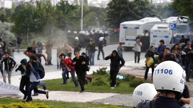 Turkish university students, who were protesting the explosions that killed tens of people in Reyhanli near the border with Syria last week, clashed with riot police at the Middle East Technical University in Ankara, Turkey, Wednesday, May 15, 2013.(AP Photo)